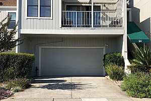 Browse active condo listings in REDWOOD HILLS